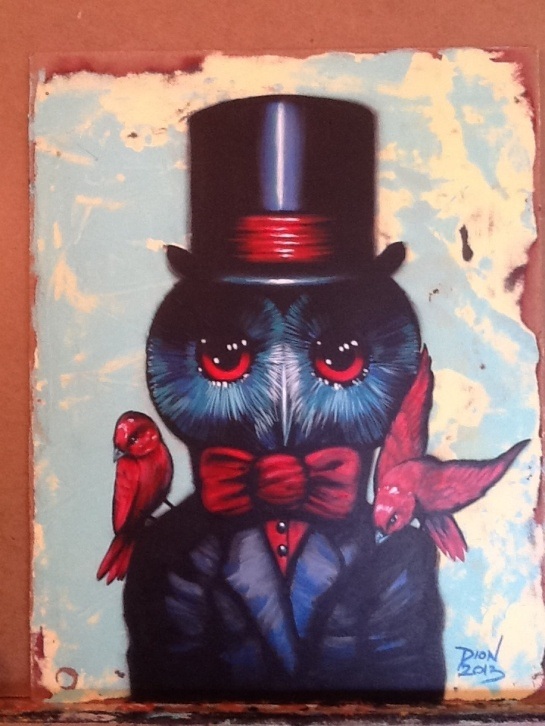 Black owl in outfit w/ red birds